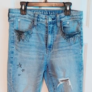 Hand painted distressed American eagle jeans